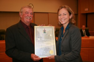 Mayor Corrigan of The City of Burnaby (L) presents proclamation to Linda Diano of The Power in Sport (R) at a ceremony on Monday, October 6, 2014.